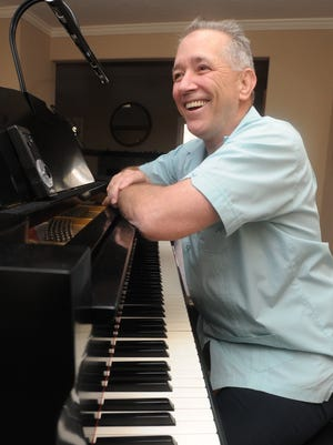 David Troy Francis with his piano at his home in Asheville in 2012.