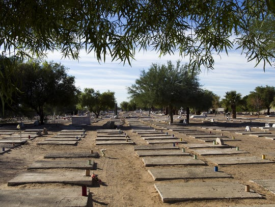 Grave markers dot the landscape inside Avondale's Goodyear