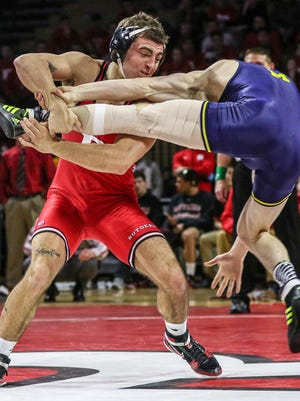 Rutgers' Richie Lewis (left) wrestles Michigan's Brian Murphy in a 157-pound bout at Sunday's meet at Rutgers.