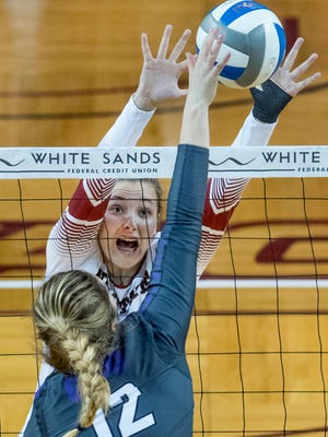 New Mexico State middle blocker Lia Mosher gets her hands out in front of the spike of Grand Canyon's Maria Adams Saturday afternoon at the Pan American Center.
