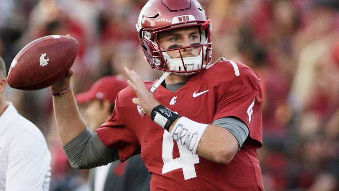 Senior Luke Falk leads the Cougars into Thursday's Holiday Bowl with questions lingering about a wrist injury.