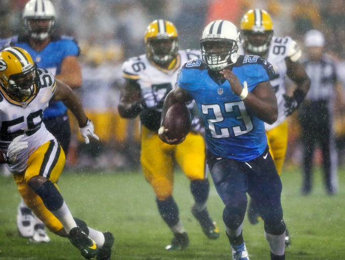 Tennessee Titans running back Shonn Greene (23) runs 13 yards for a touchdown as Green Bay Packers defenders Brad Jones (59), Mike Daniels (76) and Datone Jones (95) chase him in the first quarter of a preseason NFL football game Saturday, Aug. 9, 2014, in Nashville.