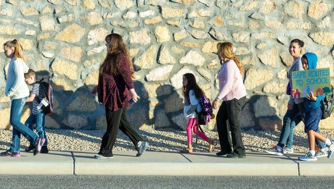 Parents, teachers, students and special guests walk along Northrise Drive near Purple Sage Drive during Walk to School Day on Wednesday, October 5, 2016, at Sonoma Elementary School. Las Cruces Public Schools hosted the events at all 25 elementary schools as part of the 20th anniversary of International Walk to School Day.
