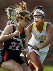 Hutchison lacrosse player Elizabeth Farnsworth (right) plays defense during a recent game against Ensworth.