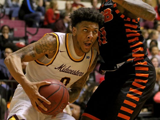 Midwestern State's Brandon Neel looks to the basket
