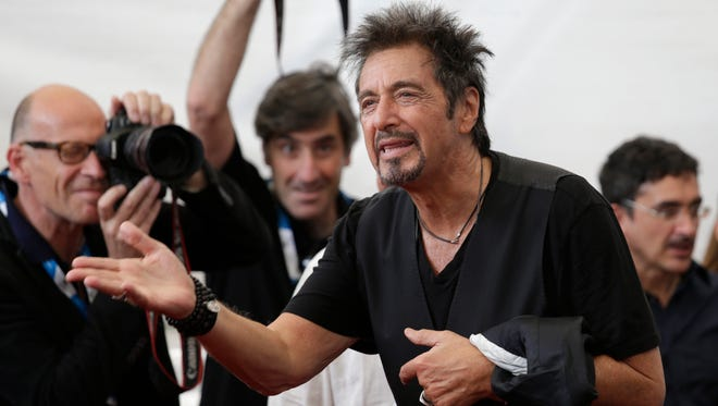Al Pacino poses for photographers during a photo call for the movie Manglehorn during the 71st edition of the Venice Film Festival in Venice, Italy, Saturday, Aug. 30, 2014.