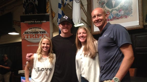 Jordan Dalton, Andy Dalton, Christi Mack and Chris Mack took a moment to celebrate the Pop-a-Shot contest at Hofbrau Haus Tuesday night. Or, they just posted for a picture afterward at the behest of a reporter.