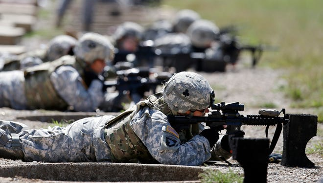 Female soldiers train on a firing range while wearing new body armor in Fort Campbell, Ky., in 2012.