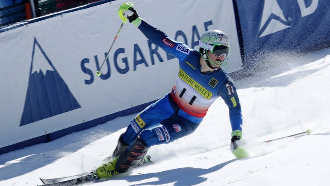 AJ Ginnis celebrates as he crosses the finish line during the Men's Slalom at the 2015 U.S. Alpine Championships at Sugarloaf. Ginnis finished second in the Slalom.