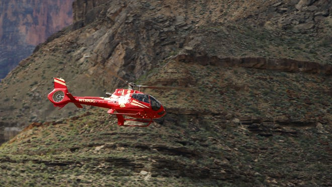 A Papillon Grand Canyon Helicopter helicopter flies over the Colorado River through the Hualapai Reservation and the adjacent western part of Grand Canyon National Park.
