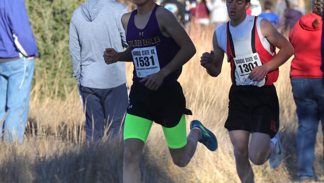 WaKeeney-Trego's Wyndom Giefer won a Class 2A cross country title on Saturday, while Hoxie's Gabriel Friess (back) was runner-up.