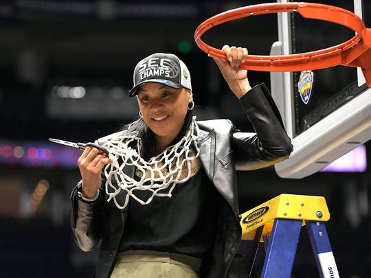 South Carolina head coach Dawn Staley places the basketball net around her neck after winning the 2018 SEC Women's Basketball Championship at Bridgestone Arena in Nashville on Sunday, March 4, 2018.