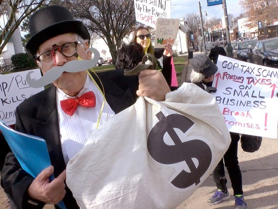 Jim Tobias, Matawan, dresses as 'Mr. Moneybags' as