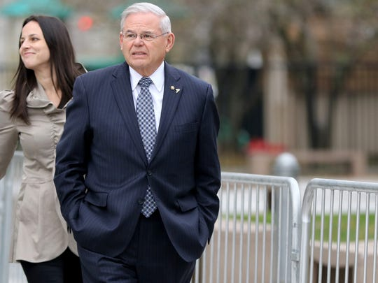 U.S. Sen. Bob Menendez is shown leving the federal courthouse in Newark in front of his daughter, Alicia Menendez, Monday afternoon, November 13, 2017.