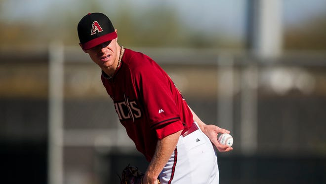 Pitcher Chase Anderson practices during the Diamondbacks spring training at Salt River Fields at Talking Stick on Sunday, Feb. 9, 2014 in Scottsdale.