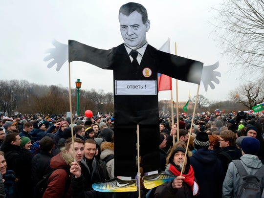 Opposition supporters with a cutout figure depicting