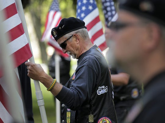 Kevin Kirst, American Legion Riders Post 38, bows his