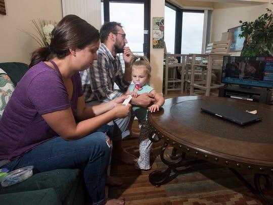 Jen and Rus Fergansky keep tabs on Hurricane Irma while