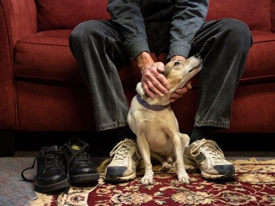 Harold Johnson pets his dog Wednesday, Jan. 24, 2018,