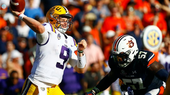 FILE - In this Sept. 15, 2018, file photo, LSU quarterback Joe Burrow (9) throws a pass during the second half of an NCAA college football game against Auburn, in Auburn, Ala. LSU (5-0, 2-0) is looking for a third resume-building win away from Death Valley. The Tigers opened the season by thumping Miami in Texas and then eked out a win at Auburn two weeks later. They play Florida in Gainesville, Fla., on Saturday. (AP Photo/Butch Dill, File)