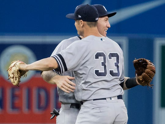 New York Yankees' Greg Bird (33) and Todd Frazier embrace