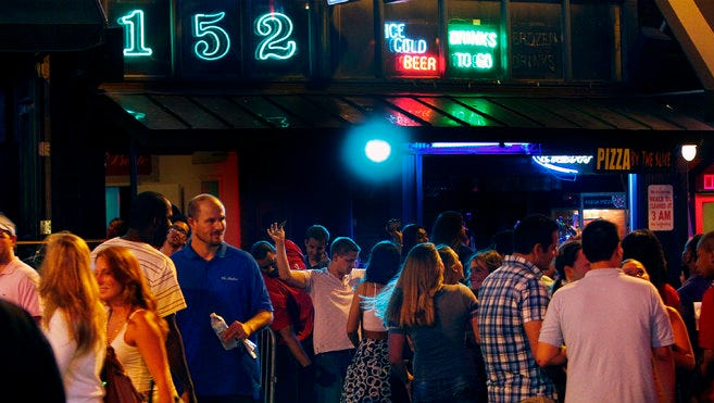 In this May 2013 file photo, as a line grows Club 152 patrons are searched before entering the establishment.