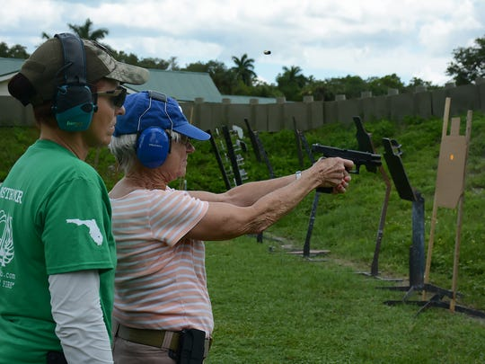 A shell casing flies as instructor Shirley Watral works with student Phyllis Westerman. The Altair Gun Club held a Pistol 1 training course specifically for women on Saturday, July 16 at their shooting facility in Copeland.