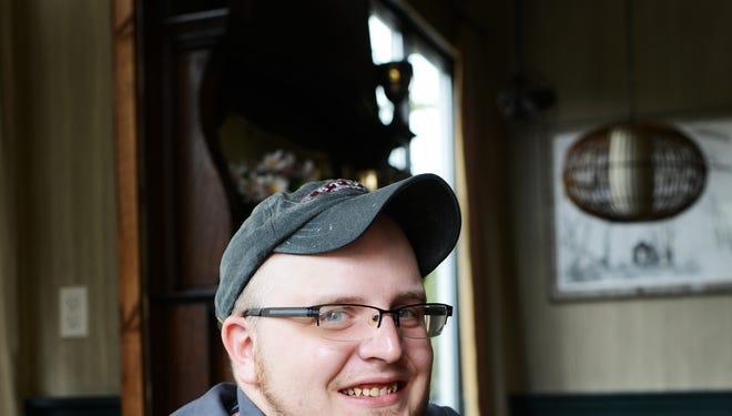 Ryan Kline is a sous chef at Storm Rhumm Bar. 8/1/13 - Erin Brethauer (ebrethau@citizen-times.com)