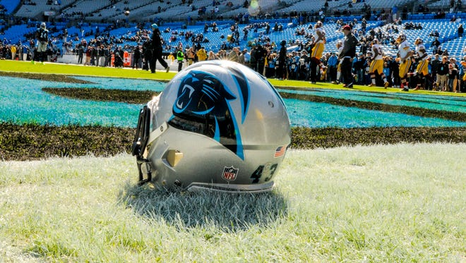 A Carolina Panthers helmet sits on the field prior to a NFL football game.