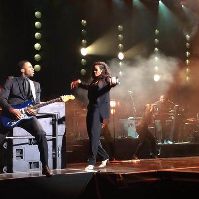 Rihanna dancing with the guitarist at DirecTV Super