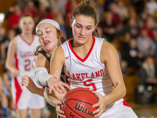 Keira Marks (5) of Lakeland and Stephanie LaGreca of Wayne Valley vie for a loose ball in the 2018 Passaic County girls basketball tournament final.