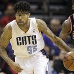 Charlotte Bobcats guard Chris Douglas-Roberts (55) brings the ball up the court against the Chicago Bulls on April 16, 2014.