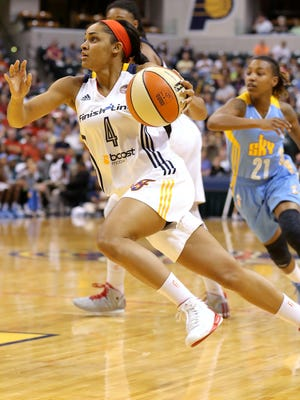 Indiana Fever guard Sydney Carter drives into the lane against the Chicago Sky inside Bankers Life Fieldhouse, on Saturday, August 16, 2014, in Indianapolis.