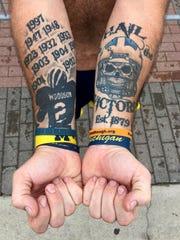 Jay Rhadigan of Windsor, Ontario shows one of his 31 Michigan football tattoos at Michigan Stadium in Ann Arbor on Saturday, September 10, 2016.