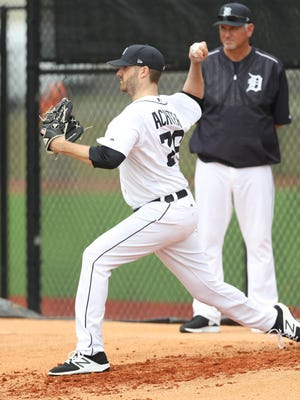 Tigers pitcher A.J. Achter  throws on the first day of spring training Feb. 14, 2017 at the renovated Publix Field at Joker Marchant Stadium in Lakeland, Fla.
