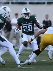 Michigan State's Madre London runs the ball against Iowa during the first quarter on Saturday, Sept. 30, 2017, at Spartan Stadium in East Lansing.