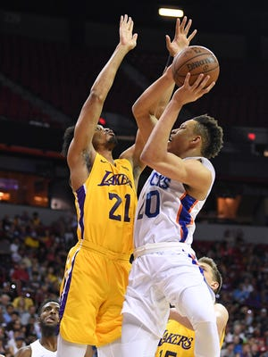 July 10: Knicks forward Kevin Knox (20) tries to shoot against Lakers defender Johnathan Williams (21).