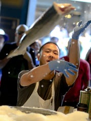 Tossing fish around is a tradition at the Pike Place Fish Market. It has evolved into a show-stopping, crowd pleaser for tourists and customers.