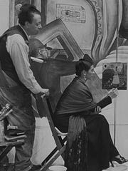 """Diego Rivera and Frida Kahlo at work near the """"Detroit Industry"""" murals at the Detroit Institute of Arts."""