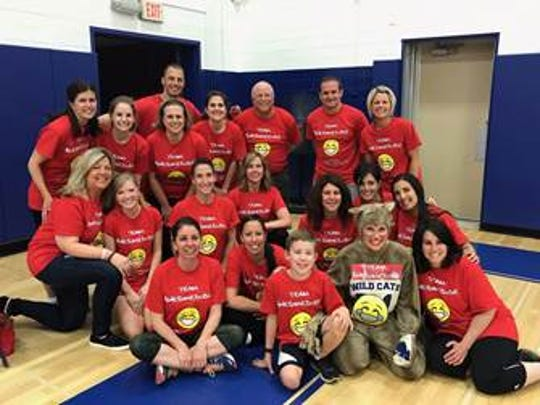 Teachers and staff representing Washington and Wilson Elementary Schools in Westfield participated in a volleyball match on May 23, with each school raising money for a charity of their choice. Washington School raised more than $1,900 for the Crohn's and Colitis Foundation. Wilson School, who won the match, collected close to $2,000 for the Valerie Fund to support one of their students diagnosed with leukemia. The teachers and staff of Washington School are pictured, with Jake wearing the T-shirt he designed, which also will be worn by his team, Awesome Dude, in the Liberty State Park Take Steps for Crohn's & Colitis Walk on Sunday, June 11.