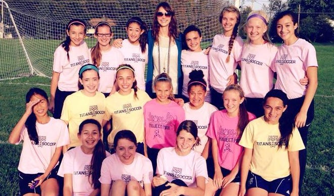 Lauren Taylor (middle, top row) and the Webster Thomas mod-A soccer team.