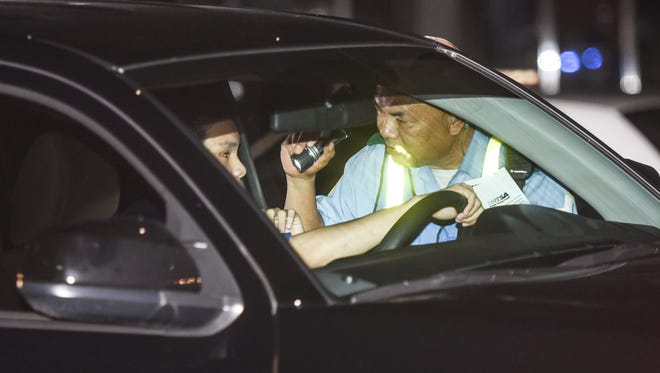 Guam Police Department Highway Patrol Division officers conduct a DUI checkpoint on Marine Corps Drive in Tamuning on Friday, July 7, 2017.