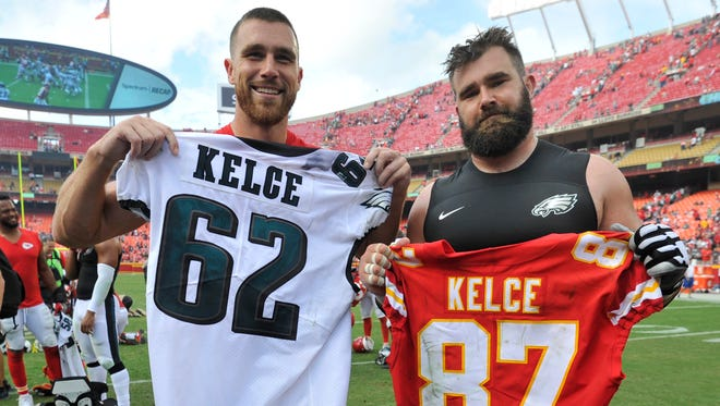 Kansas City Chiefs tight end Travis Kelce, left, and Philadelphia Eagles center Jason Kelce (62) exchange jerseys following an NFL football game in Kansas City, Mo., Sunday, Sept. 17, 2017. (AP Photo/Ed Zurga)