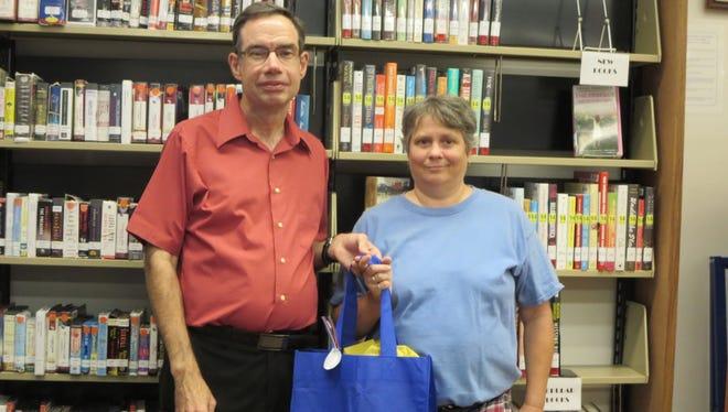 Silver Medal winner Kathy Webb, right, with Salem Branch Manager Dan Polk.