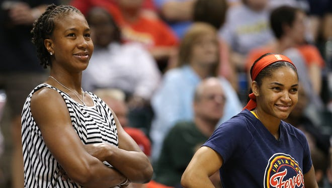 Indiana Fever forward Tamika Catchings watches from the bench against the Phoenix Mercury inside Bankers Life Fieldhouse, Friday, June 27, 2014, in Indianapolis. Phoenix won the game 81-76.