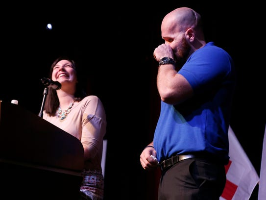 Aaron Pearson reacts as his wife, Amanda, laughs while