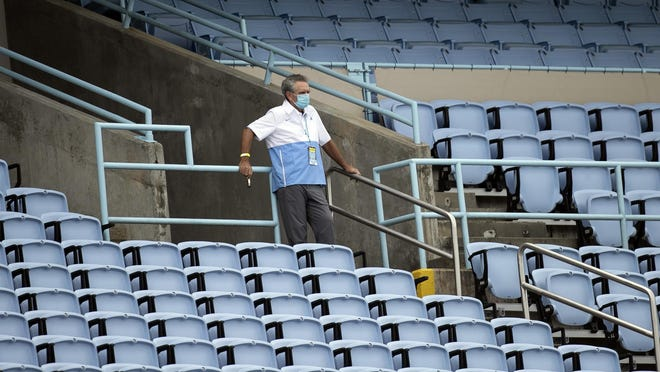 Athletics director Bubba Cunningham looks on during the fourth quarter of North Carolina's defeat of Syracuse last weekend at empty Kenan Stadium.