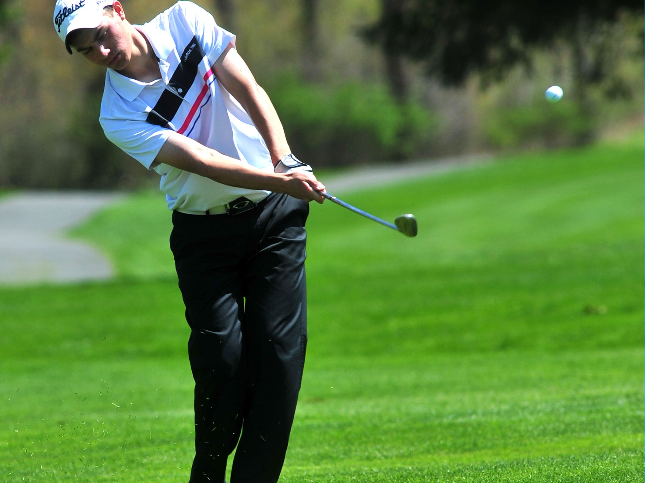 Tommy Hayes of West Morris drives on the 18th fairway at the Morris County Tournament.