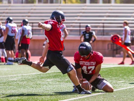 Southern Utah kicker Manny Berz (18) kicks a field