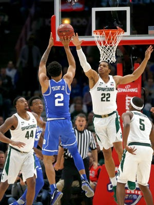 Duke guard Gary Trent Jr. (2) shoots over Michigan State guard Miles Bridges during the first half of an NCAA college basketball game Tuesday, Nov. 14, 2017, in Chicago.